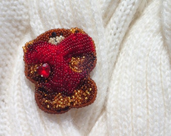 Brooch handmade with beads and beads
