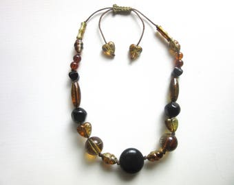 Chunky Lucite Bead Necklace Black Clear & Translucent Amber Gold Painted Squiggles Individually Knotted Adjustable 18 - 21 Inches 1970s