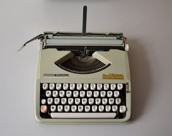 Vintage Hermes Baby Portable Typewriter / portable typewriter / in perfect working condition