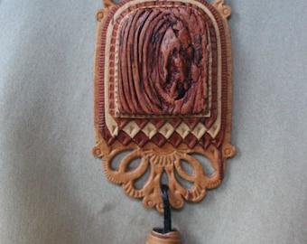 Birch bark pendant  on leather cord .