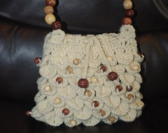 Handmade crochet Purse with wooden bead accents, including wooden bead handles, fully lined with drawstring closure.
