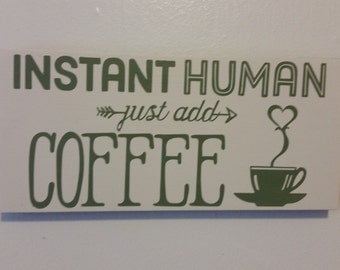 "Wooden ""Instant human: just add coffee"" sign"