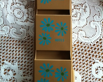 A Plastic Three Compartment Wall Organizer Key Holder With A Blue Daisy/Flower Design That Reads Letters, Notes, Misc