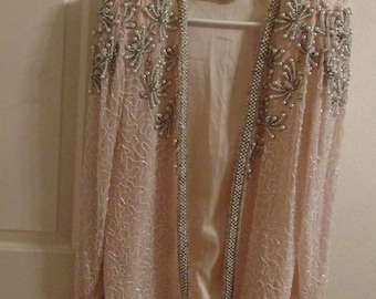 Vintage SylviaAnn elegant beaded evening jacket. Champagne pink with silver/gray/offwhite pearls and beading.