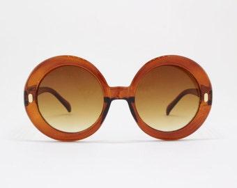 60s style sunglasses, round oversized glasses, brown frame, brown lens, women's eyewear. 70s.