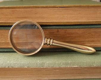 Vintage brass pocket sized (small) magnifying glass. Solid brass with clear acrylic convex lens. Removable handle.