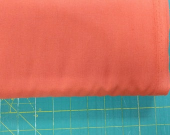 Solid orange fabric. Bittersweet Premium Colorworks quilters cotton quilting 9000 381 Northcott 3189