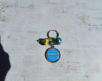 So There's This Roughneck Bottlecap Key chain Blue and Yellow  Beads