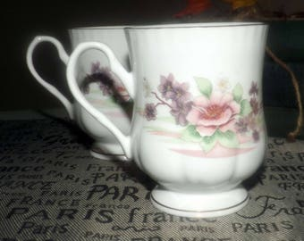 Vintage (1980s) Crown Ceramics India bone china footed coffee | tea mug. Pink and purple flowers, scalloped gold edge, accents.