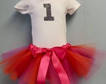 First Birthday tutu set. Comes with full tulle tutu, onesie with glittered age on, coordinating headband and flower