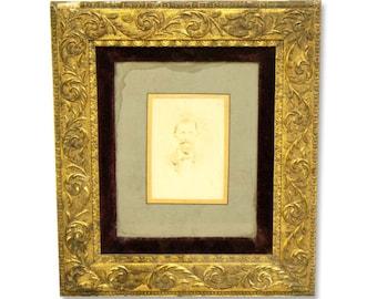 Ornate framed portrait