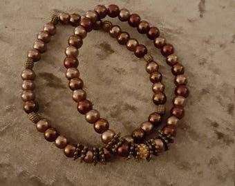 Set of 2 brown and bronze tones bracelets