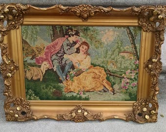 Beautiful Vintage Needlepoint of Man and Woman in nature with ornate gold frame