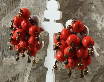 Flirty Signed Coro Bright Red Orange Glass Bead Cha Cha Earrings Screwback Dangling Tarnished Gold Tone Beads 1940's