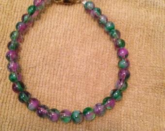 Green and purple bead bracelet. Green bead bracelet. Purple bead bracelet. Purple bracelet. Green bracelet. Bead bracelet. Beaded. TBFB0431
