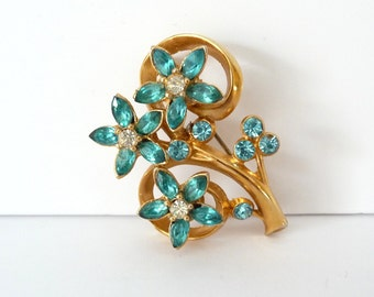 Aqua Blue Flower Rhinestone Brooch Pin Gold Tone Blue Clear Rhinestones Vintage Costume Jewelry from TreasuresOfGrace