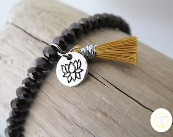 Black Glass Beads Bracelet lotus jet and mustard yellow Pompom