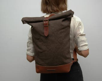 waxed Canvas rucksack/backpack, khaky color, hand waxed , with handles, leather base closures