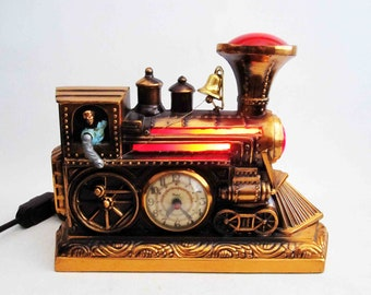 Vintage Light Up, and Moving Train Clock by United. Circa 1930's.