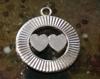 Vintage sterling silver two hearts in a circle charm