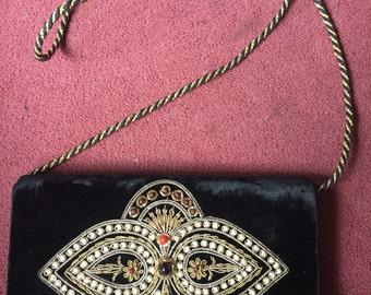 Beautiful beaded shoulder bag on black velvet