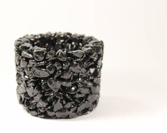 Flowerpot,candlestick, made from black marble pebbles.