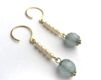Tiny cream pearl earrings with smoky blue crystal drops.  Brass nickel free ear wires.