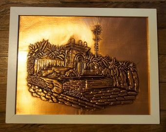 Picture in embossed copper Source