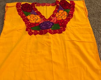 Yellow handmade blouse with flowes