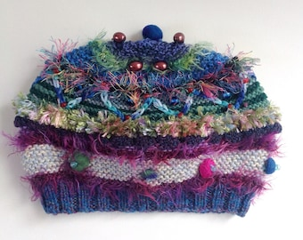 Embellished knit hat. 15 years to adult.. Multiple colours, textures,beads,felt and embroidered embellishments. One of a kind.