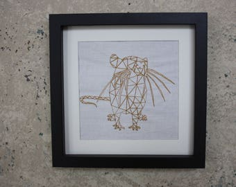 Embroidery rat on hand-woven linen