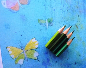 Big brooch with colored pencils in shades of green