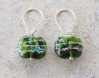 Sparkly green glass earrings. Beads made from a champagne bottle and decorated with fine silver wire. Makes a great gift for mum.
