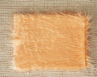 Fur fabric long-haired 55*47 cm. Peach colour.