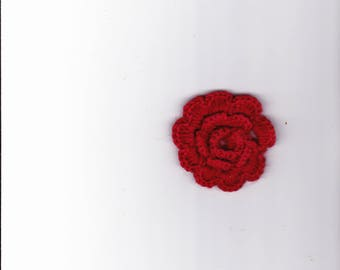 Red crocheted flower
