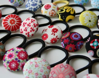 3 pack: choose the ones you want and save.  28mm/1 1/8 inch fabric covered button hair elastics.