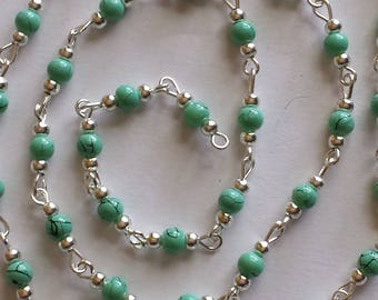 55cm of chain/beads 4mm glass turquoise/black