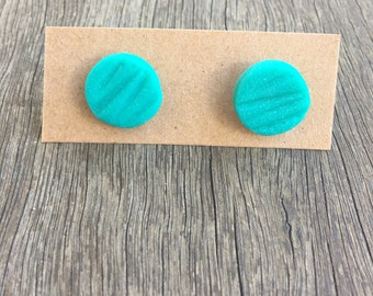 Teal clay earrings.