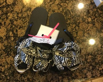 Ribbon wrapped layered zebra flip flops size 1-2 with crystals