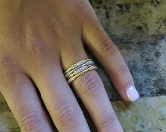 Four tone stackable diamond rings.
