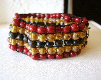 Red, yellow, brown and black beaded stretch bracelet