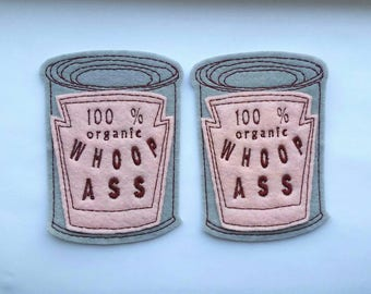 Set of 2 can of whoop ass iron on felt patch appliques in gray and pink felt with burgundy embroidery thread