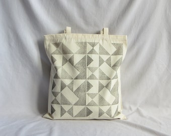 Heavy-duty canvas tote bag hand-printed with 'Signals' design in black