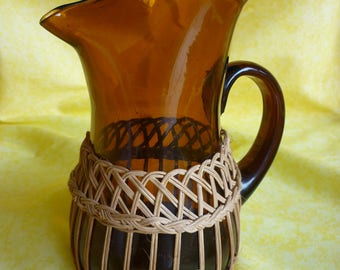 Large vintage mouth blown glass decanter amber-colored with braided rattan