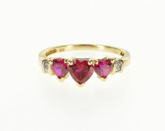10k Three Stone Ruby* Heart Diamond Accented Ring Gold