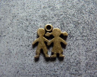2 boy and girl with metal copper charms