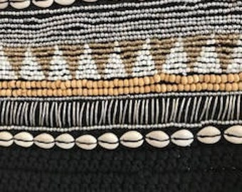 Handwoven macrame black wall hanging with shells and beading