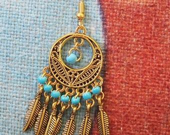 Gold feather chandelier earrings, tribal turquoise jewelry, statement earrings, gold plated earrings, boho earrings, hippie earrings.