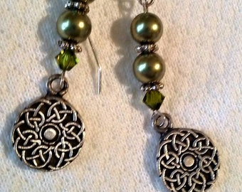 Olive green luster and sterling silver pierced earrings with Celtic knot charms.