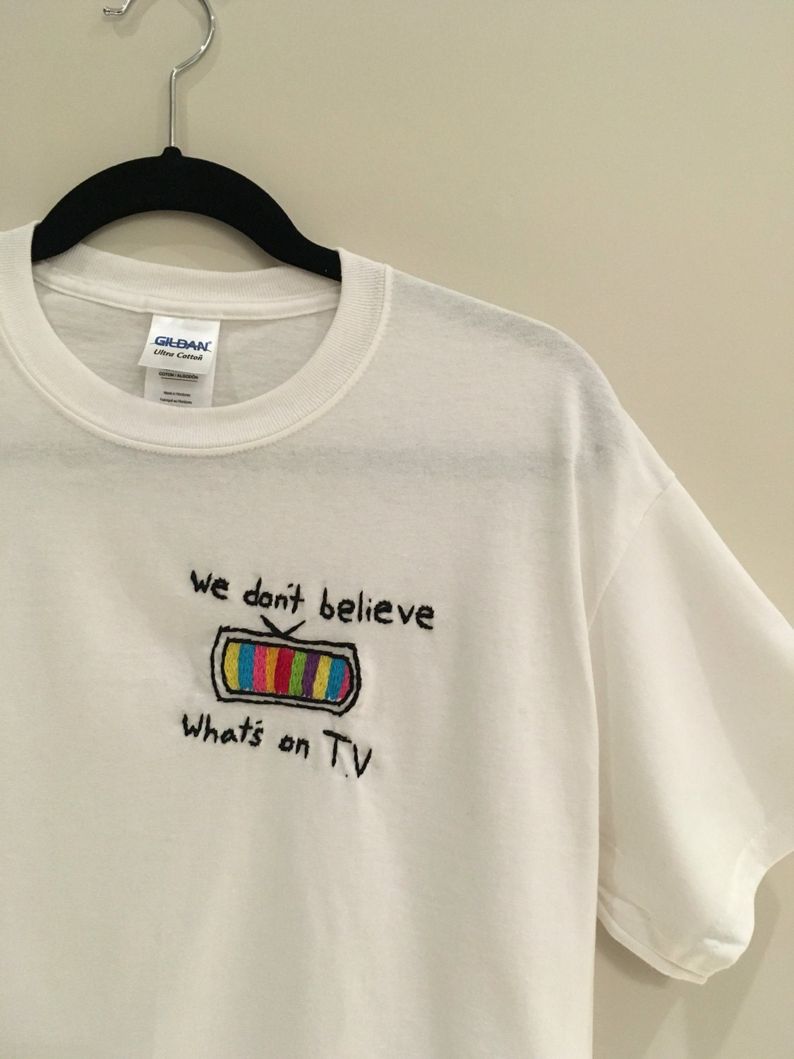 We don 39 t believe whats 39 s on t v embroidered t shirt for It s all custom t shirts and embroidery atlanta
